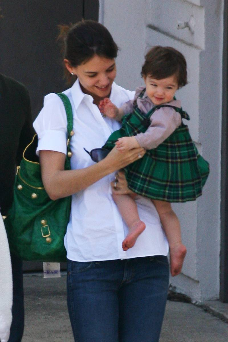 Tom Cruise and Katie Holmes with daughter Suri on St. Paddy's Day
